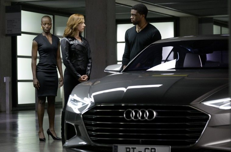 From right: Black Panther/ T'Challa (Chadwick Boseman), Black Widow (Scarlet Johansson) and security chief (Florence Kasumba).